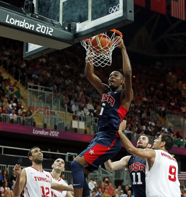 Kevin Durant of the U.S. dunks against Tunisia during their men's preliminary round Group A basketball match at the Basketball Arena during the London 2012 Olympic Games July 31, 2012.