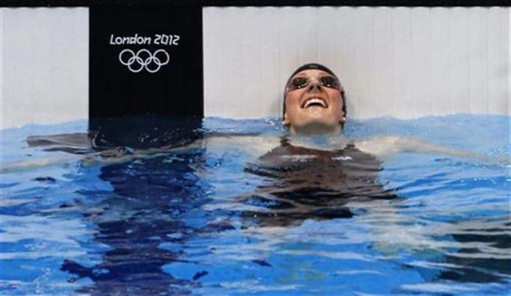 Missy Franklin of the U.S. smiles after winning the women's 100m backstroke final at the London 2012 Olympic Games at the Aquatics Centre July 30, 2012.