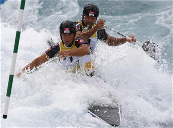 Slovakia's Pavol and Peter Hochschorner compete in the men's canoe double (C2) heats at the Lee Valley White Water Centre during the London 2012 Olympic Games July 30, 2012.