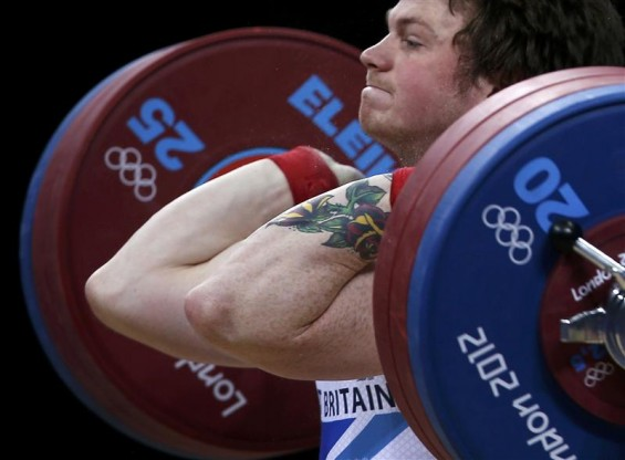 Great Britain's Jack Oliver competes on the men's 77Kg Group B weightlifting competition at the ExCel venue at the London 2012 Olympic Games August 1, 2012.