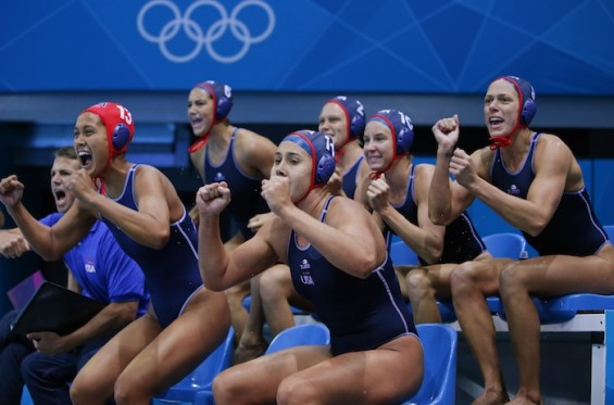U.S. official Dan Klatt and players of the team react during their women's preliminary round Group A water polo match against Spain during the London 2012 Olympic Games at the Water Polo Arena