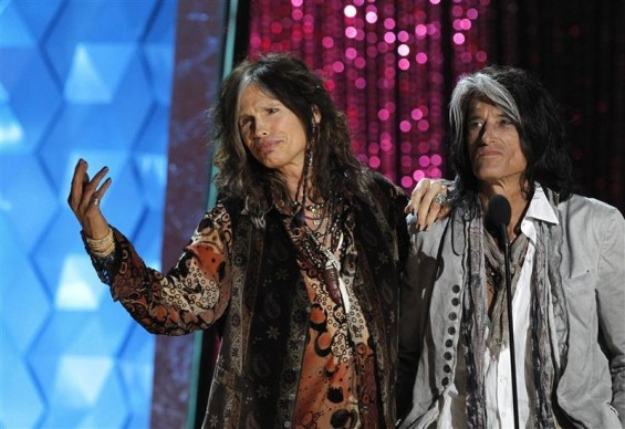 Steven Tyler (L) and Joe Perry of Aerosmith take the stage to introduce actor Johnny Depp, recipient of the MTV Generation Award, at the 2012 MTV Movie Awards in Los Angeles, June 3, 2012.