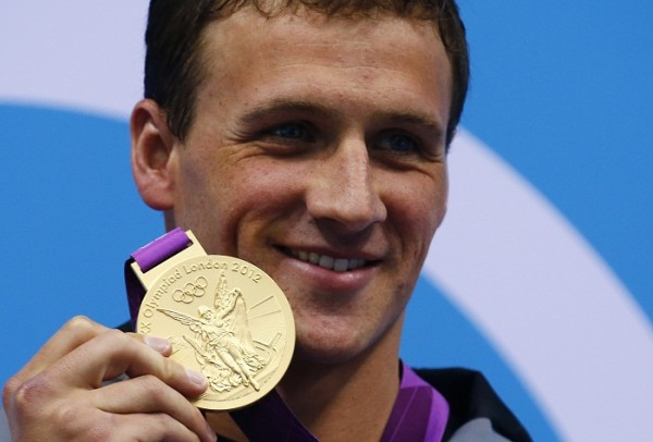 Ryan Lochte of the U.S. poses with his gold medal on the podium after winning the men's 400m individual medley final at the London 2012 Olympic Games at the Aquatics Centre July 28, 2012.