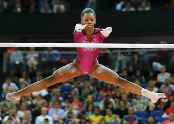 Gabrielle Douglas of the U.S. performs on the asymmetric bars during the women's individual all-around gymnastics final in the North Greenwich Arena at the London 2012 Olympic Games August 2, 2012.