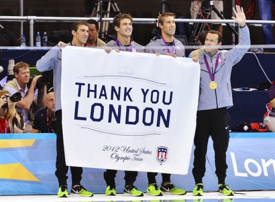 Michael Phelps, Nathan Adrian, Matthew Grevers and Brendan Hansen of the U.S. hold a banner thanking host city London, after receiving their gold medals for the men's 4x100m medley relay final during