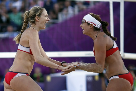 Kerri Jennings and May-Treanor of the U.S. women&#039;s beach volleyball team celebrating above