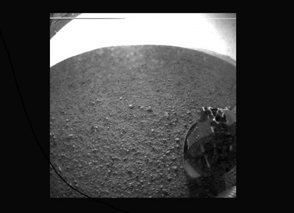 "This is the first image taken by NASA's Curiosity rover, which landed on Mars the evening of Aug. 5 PDT (morning of Aug. 6 EDT). It was taken through a ""fisheye"" wide-angle lens on one of the rover's"