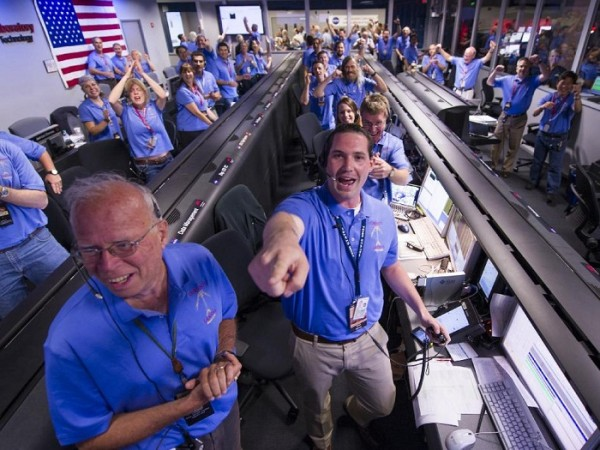 The Mars Science Laboratory (MSL) team in the MSL Mission Support Area reacts after learning the the Curiosity rover has landed safely on Mars and images start coming in at the Jet Propulsion Laborato