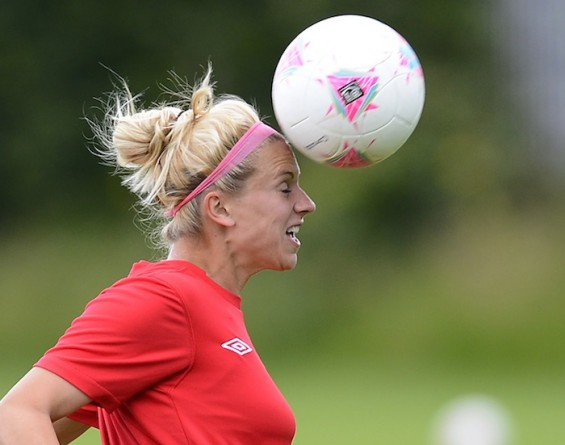 Canada&#039;s football player Lauren Sesselmann heads the ball during a training session at the London 2012 Olympic Games at the Grammer School Manchester