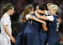 USA players celebrate defeating Canada in the women's semi final soccer match at the London 2012 Olympic Games at Old Trafford in Manchester