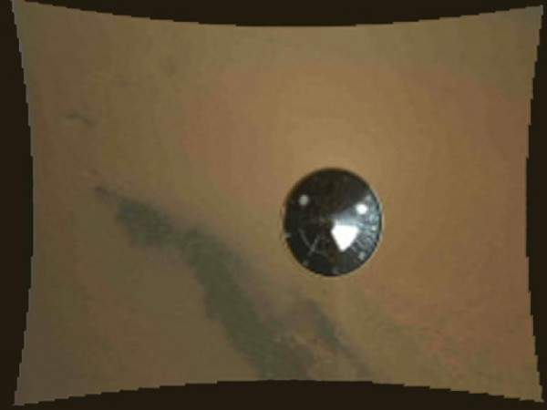 This color thumbnail image was obtained by NASA's Curiosity rover during its descent to the surface of Mars on Aug. 5 PDT (Aug. 6 EDT). The image was obtained by the Mars Descent Imager instrument kno
