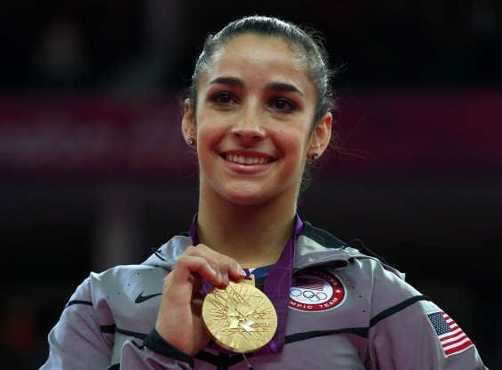 Alexandra Raisman of the U.S. celebrates winning a gold medal during the women&#039;s gymnastics floor exercise victory ceremony in the North Greenwich Arena during the London 2012 Olympic Games August 7, 