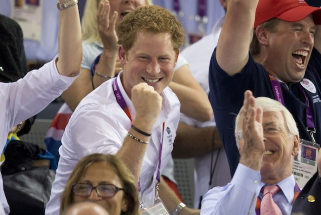 Britain's Prince Harry, Peter Phillips and former Prime Minister John Major react as Britain's Chris Hoy wins the gold medal for the men's keirin at the Velodrome during the London 2012 Olympic Games