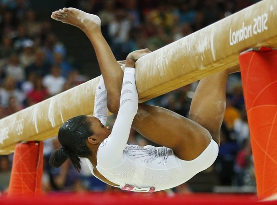 Gabrielle Douglas of the U.S. falls during the women's gymnastics balance beam final in the North Greenwich Arena during the London 2012 Olympic Games August 7, 2012.