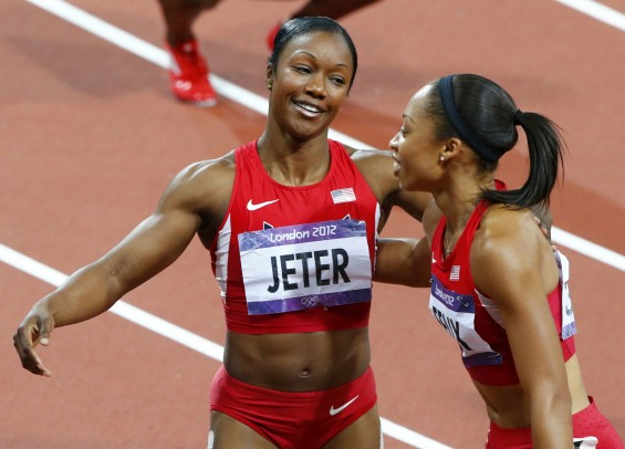 Bronze medal winner Carmelita Jeter (L) of the U.S. congratulates gold medal winner Allyson Felix of the U.S. after the women's 200m final during the London 2012 Olympic Games at the Olympic Stadium A