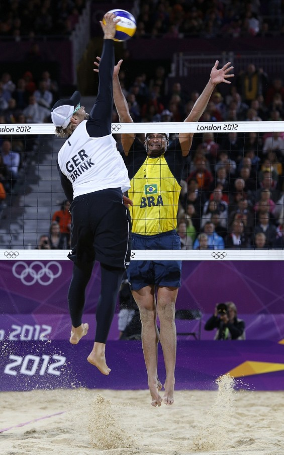Men's beach volleyball Team Germany spikes during the Olympic quarterfinals