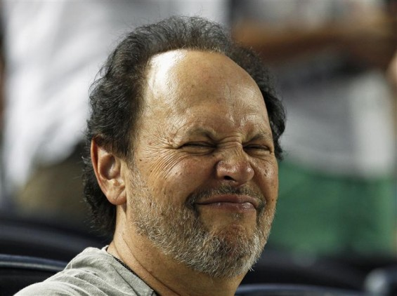 Actor Billy Crystal grimaces as he watches the New York Yankees take on the Toronto Blue Jays during their MLB American League baseball game at Yankee Stadium in New York, July 16, 2012.