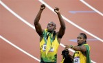 Jamaica's Usain Bolt (L) gestures beside second-placed team mate Yohan Blake after winning the men's 200m final during the London 2012 Olympic Games at the Olympic Stadium August 9, 2012.
