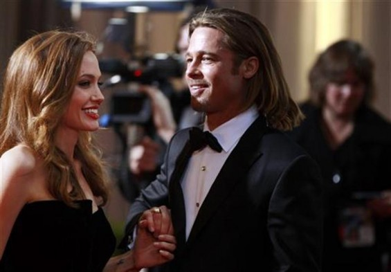 Actress and presenter Angelina Jolie and her partner actor Brad Pitt arrive at the 84th Academy Awards in Hollywood, California, February 26, 2012.