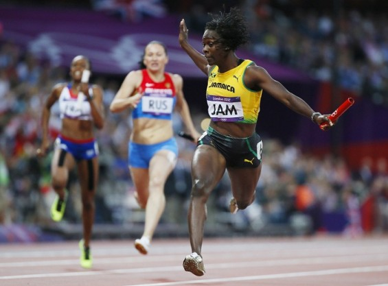 Jamaican runner Kerron Stewart performs in the 4x100-meter relay