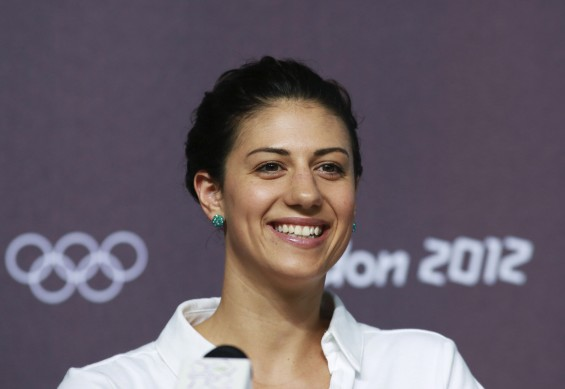 Australian swimmer Stephanie Rice smiles during a news conference at the Media Press Centre in London 2012 Olympic Park in Stratford, east London July 23, 2012.