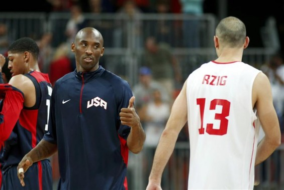Kobe Bryant of the U.S. (L) gives a thumbs-up to Tunisia's Amine Rzig after their game at the men's preliminary round Group A basketball match at the Basketball Arena during the London 2012 Olympic Ga