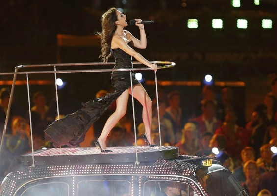 Victoria Beckham of British pop group Spice Girls performs on top of a London taxi during the closing ceremony of the London 2012 Olympic Games at the Olympic Stadium August 12, 2012.