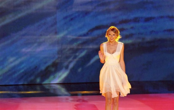 Singer Taylor Swift walks on stage at the Teen Choice Awards at the Gibson amphitheater in Universal City, California July 22, 2012.