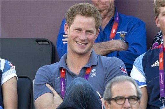 Britain&#039;s Prince Harry watches the women&#039;s beach volleyball bronze medal match between Brazil and China at Horse Guards Parade during the London 2012 Olympic Games August 8, 2012. 