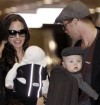 U.S. actress Angelina Jolie and actor Brad Pitt, each carrying their twins Vivienne Marcheline (L) and Knox Leon, arrive with all their children at Narita airport, near Tokyo, January 27, 2009. Pitt i