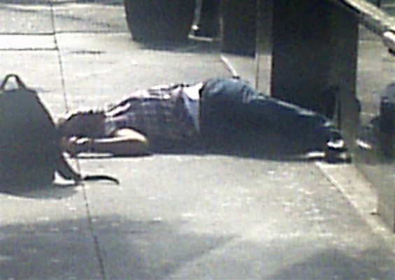 The body of a man lies on the sidewalk near the Empire State Building following a shooting in New York August 24, 2012. Two people were killed and at least eight were wounded in a shooting outside the
