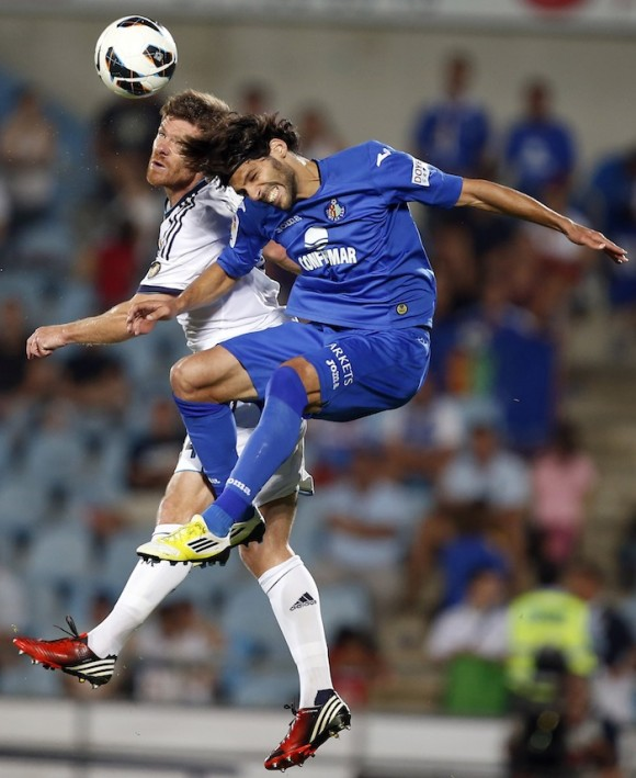 Real Madrid's Alonso and Getafe's Lafita head the ball during their Spanish first division soccer match in Getafe