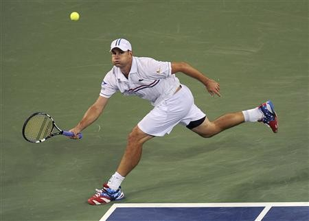 Andy Roddick of the U.S. hits a return to Bernard Tomic of Australia during their match at the US Open men's singles tennis tournament in New York, August 31, 2012.