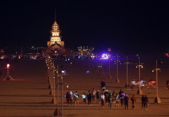 People walk towards the Temple of Juno, which is alit at night, during the Burning Man 2012 &#034;Fertility 2.0&#034; arts and music festival in the Black Rock Desert of Nevada August 29, 2012. 