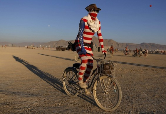 &#034;Nick&#034;, his playa name, rides across the desert during the Burning Man 2012 &#034;Fertility 2.0&#034; arts and music festival in the Black Rock Desert of Nevada August 29, 2012. 