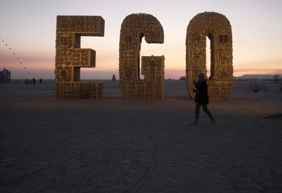   Ruth Kidd explores the art piece &#034;Ego&#034; before sunrise during the Burning Man 2012 &#034;Fertility 2.0&#034; arts and music festival in the Black Rock Desert of Nevada, August 29, 2012.   