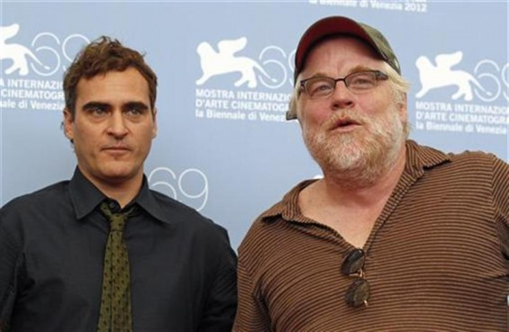 U.S. actors Philip Seymour Hoffman (R) and Joaquin Phoenix pose during a photocall for the movie &#034;The Master&#034; at the 69th Venice Film Festival September 1, 2012. 