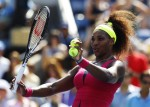 Serena Williams of the U.S. prepares to hit autographed balls into the crowd after defeating Ekaterina Makarova of Russia during their women's singles match at the U.S. Open tennis tournament in New Y