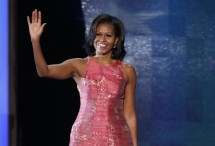 U.S. first lady Michelle Obama waves as she arrives to address delegates during the first session of the Democratic National Convention in Charlotte, North Carolina, September 4, 2012.