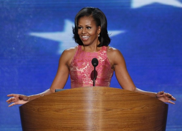 U.S. first lady Michelle Obama smiles as she arrives to address delegates during the first session of the Democratic National Convention in Charlotte, North Carolina, September 4, 2012.