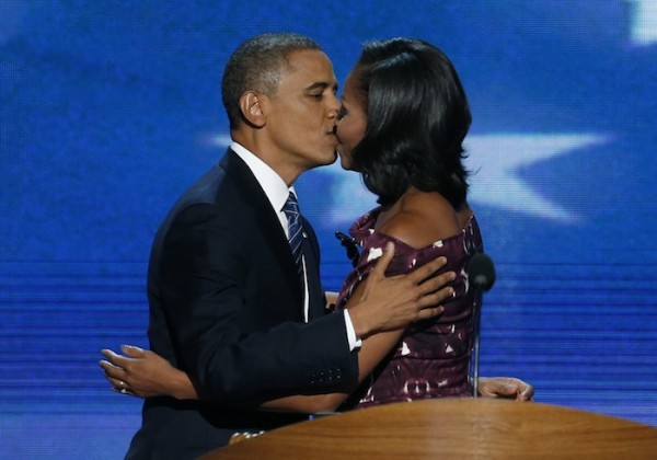 U.S. President Barack Obama kisses his wife, first lady Michelle Obama, as he arrives to address delegates during the final session of the Democratic National Convention in Charlotte