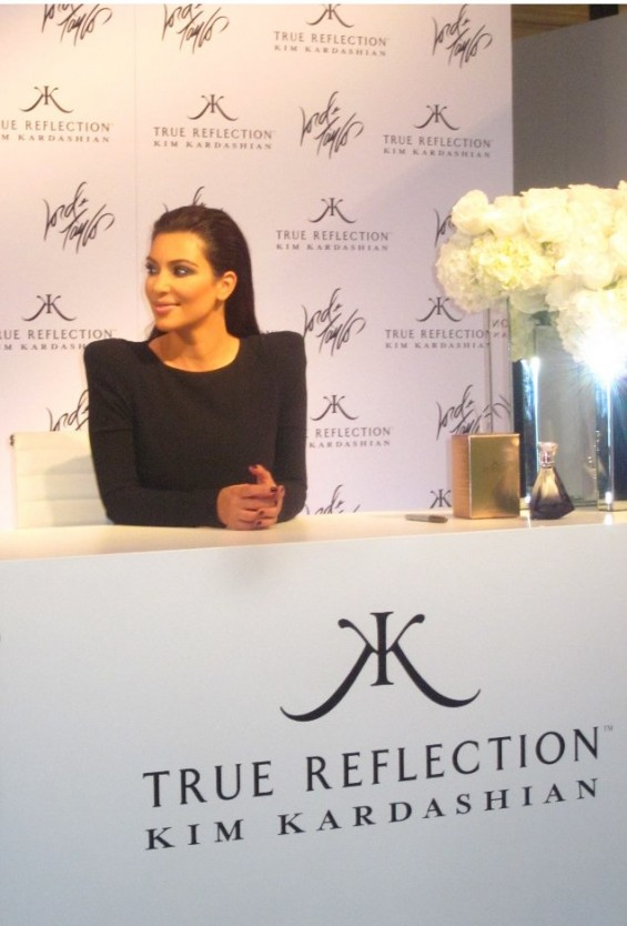 Kim Kardashian at a signing for her new fragrance True Reflection