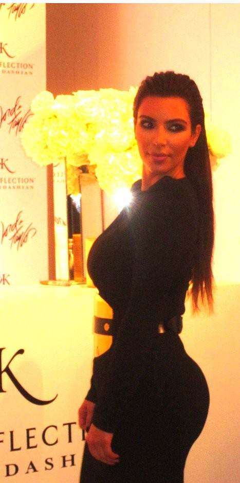 Kim Kardashian posed for photographers at Lord & Taylor