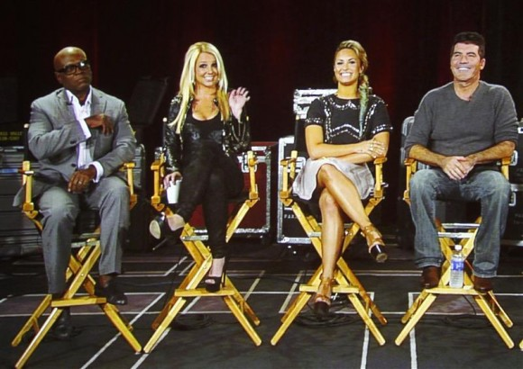 "Judges from the reality series ""The X Factor"" (L-R) L.A. Reid, Britney Spears, Demi Lovato and Simon Cowell are pictured on a video screen via satellite from Miami, Florida, during a panel discussion"