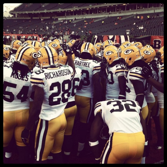 The Green Bay Packers huddle together before a game