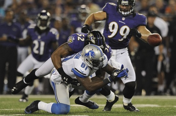 The Baltimore Ravens take down Detroit Lions wide receiver Calvin Johnson