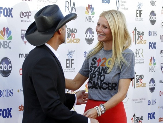 Country musician Tim McGraw greets actress Gwyneth Paltrow as they arrive for the Stand Up To Cancer fundraising telethon at the Shrine Auditorium in Los Angeles, California, September 7, 2012.
