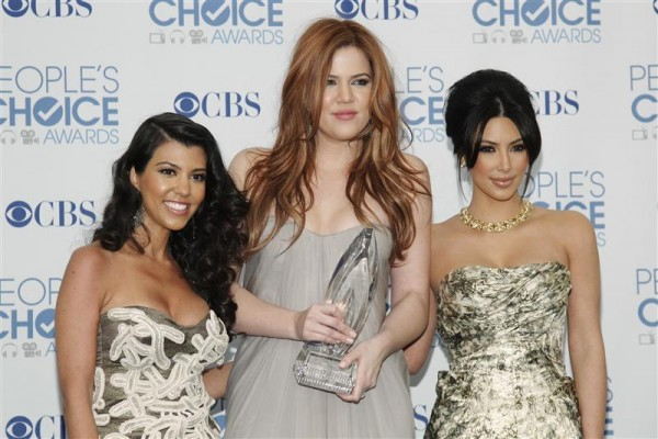 Reality television sisters (L-R) Kourtney, Khloe and Kim Kardashian pose with their favorite guilty pleasure award for 'Keeping Up with the Kardashians' at the 2011 People's Choice Awards in Los Angel