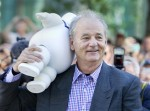 Actor Bill Murray carries a marshmallow doll he received from a fan as he arrives to the gala presentation for the film 'Hyde Park on Hudson' during the 37th Toronto International Film Festival, Septe