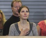 Amanda Knox pauses emotionally while speaking during a news conference at Sea-Tac International Airport, Washington after landing there on a flight from Italy, October 4, 2011. Amanda Knox returned ho